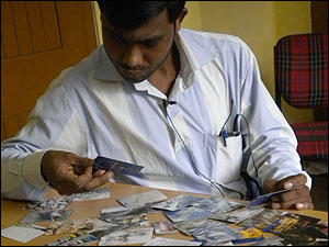 Microfinance middle manager works with CCL's Visual Explorer cards.