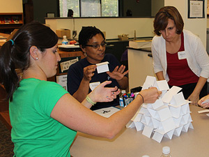 Ravenscroft teachers practice teamwork during Index Card Castle activity.