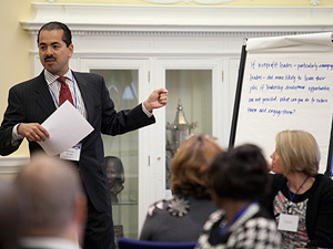 Richard Brown of American Express interacts with a small group at the White House Nonprofit Forum.